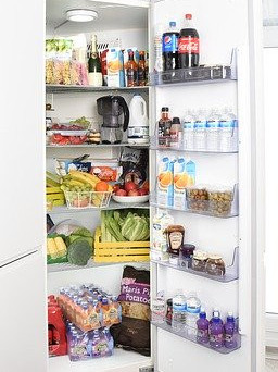 How to store food in a refrigerator - fridge door open with food in side