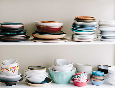 Organising food cupboards - kitchen bowls on shelves