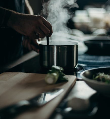 Tips for cooking in bulk - pot of food cooking with steam