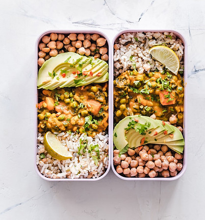 Tips for cooking in bulk - two meal prep food containers with beans, avocado