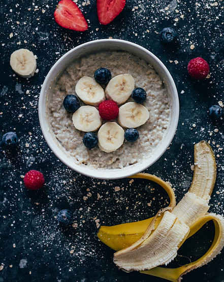 Best cheap healthy foods - porridge bowl with fruit on table