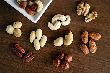 Best cheap healthy foods - various sample of nuts arranged on table