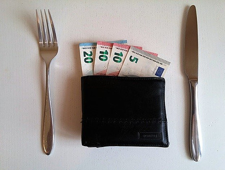 Best cheap healthy foods - wallet with money in centre of table with fork and knife