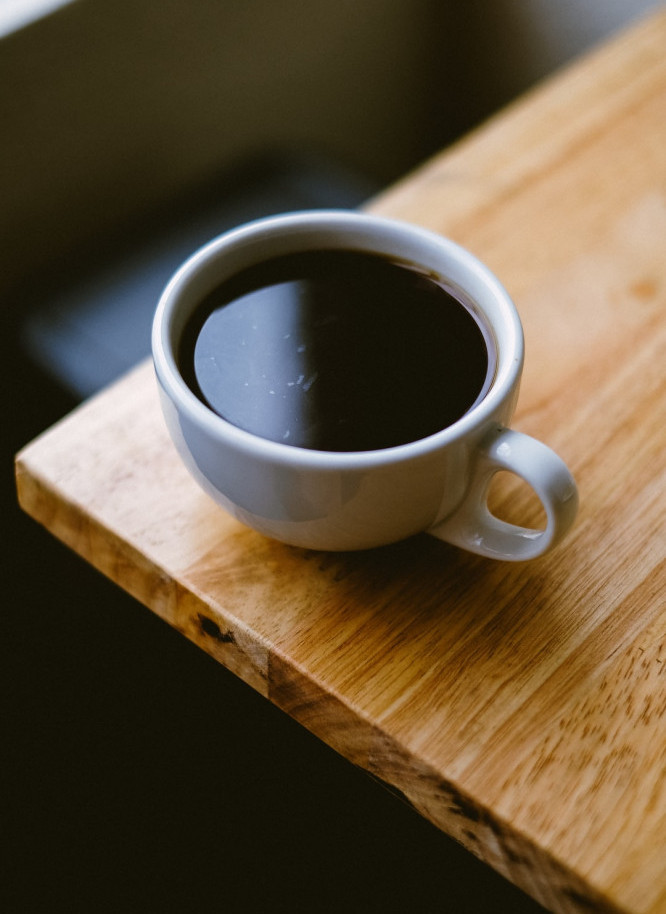Best low calorie beverages - Cup of black coffee americano on coffee table