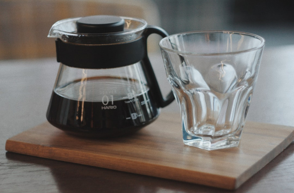 Healthy cooking with gadgets - coffee jug beside empty glass