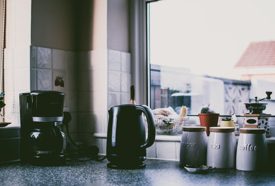 Healthy cooking with gadgets - coffee machine and kettle on kitchen counter