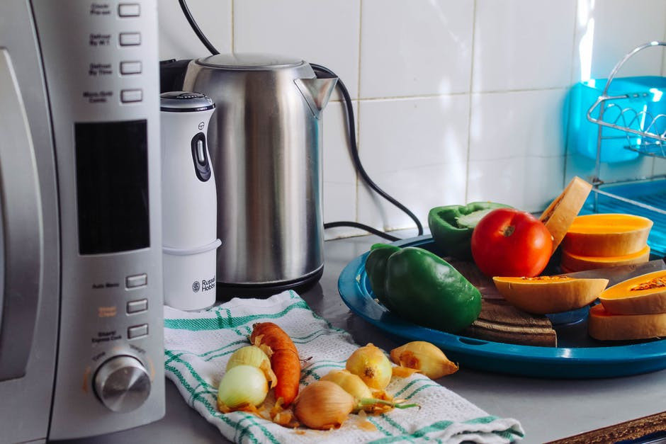 Healthy cooking with gadgets - kitchen appliances beside vegetables