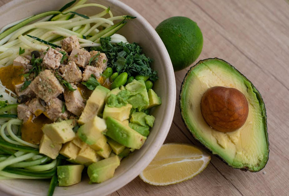 How to make salad taste better - Half an avocado with avocado cubes in a salad