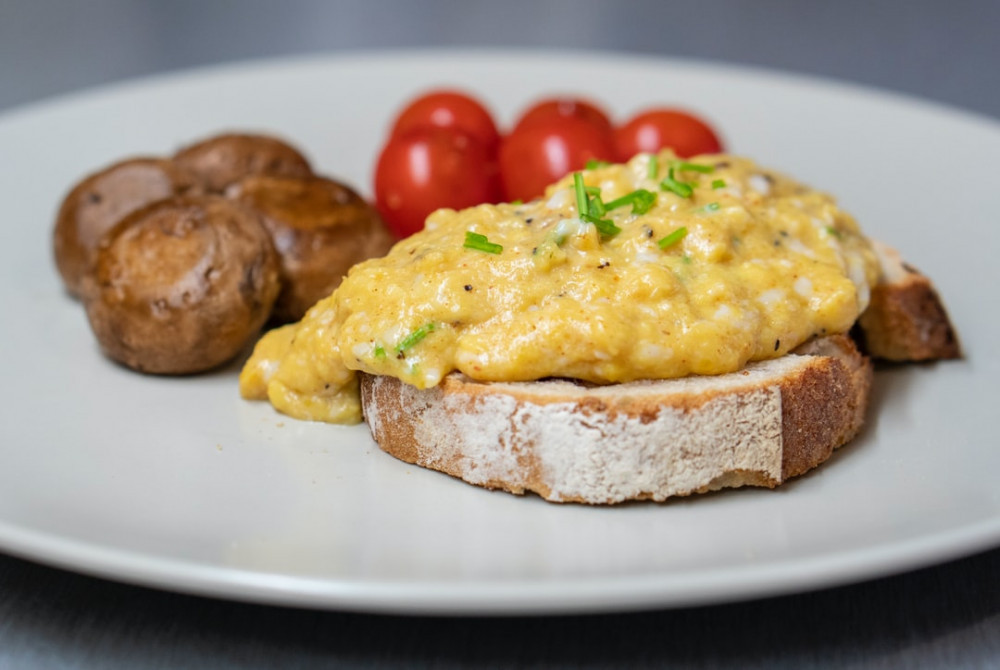 Healthy toast toppings - scrambled egg on soda bread with mushrooms and tomatoes