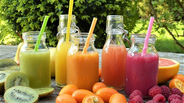 How to make smoothies healthy - Jars of fruit smoothies on a table with fruit