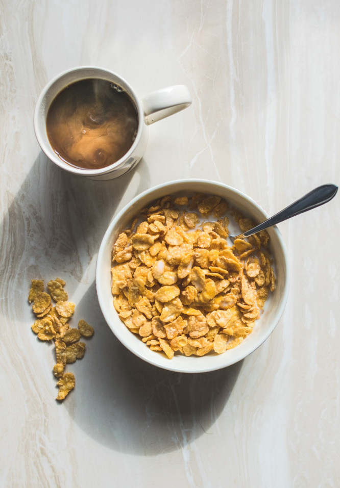 Best ways to use protein powder - Bowl of cornflakes in milk with coffee