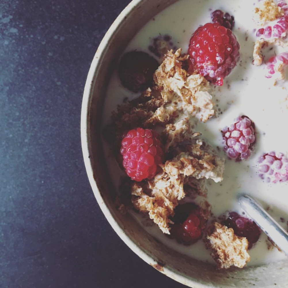 Best ways to use protein powder - Bowl of weetabix mixed with berries and milk