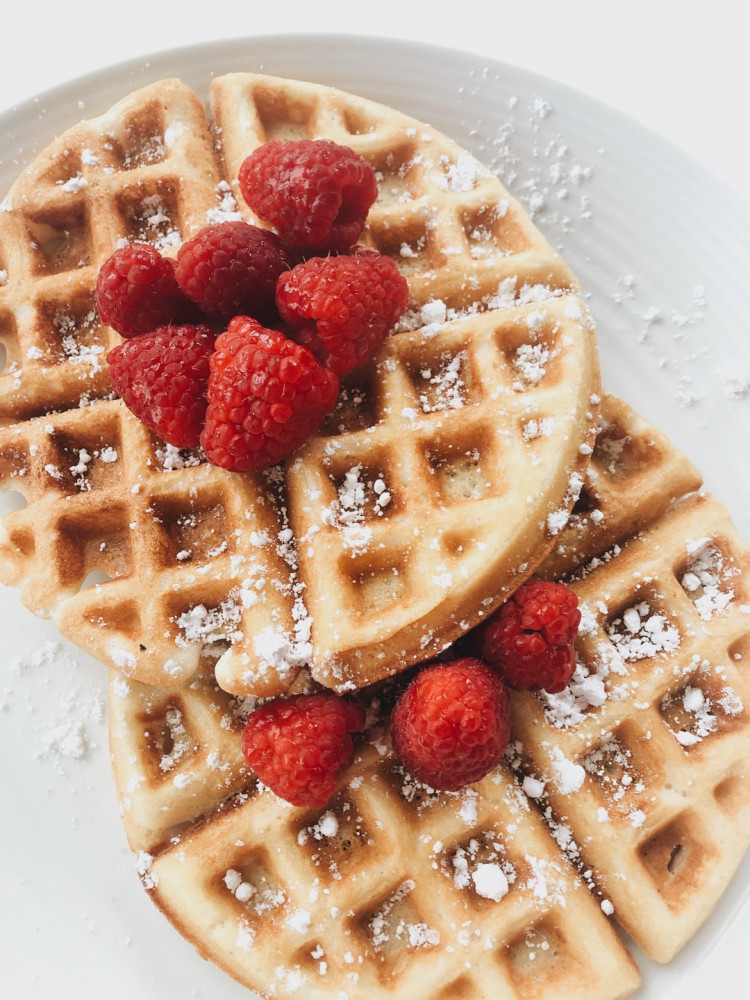 Best ways to use protein powder - Round waffles sprinkled with sugar and raspberries