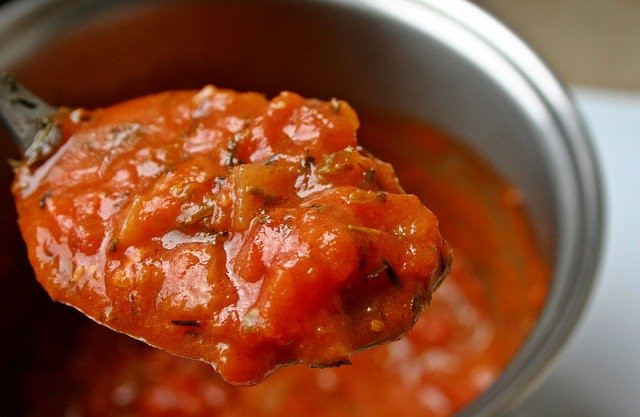 Best ways to use protein powder - Spoon of pasta sauce from pot