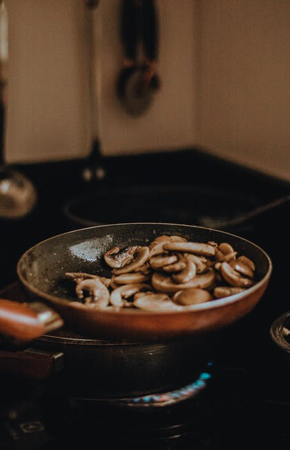 What are healthy cooking methods? - Mushroom sautéeing in pan