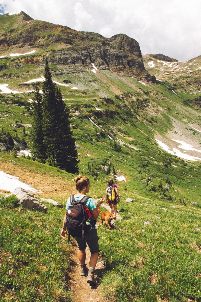 Hiking gifts for women - women hiking down a mountain